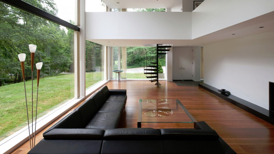 living room with floor to ceiling picture windows installed