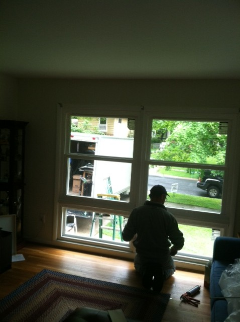 worker completing picture window replacement