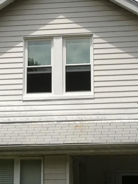second floor window installation white facade