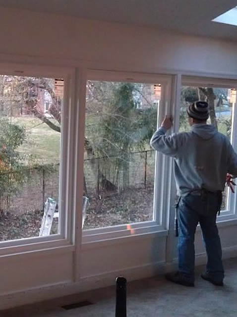 worker replacing picture windows