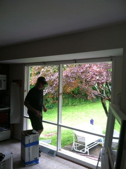 worker fixing picture window