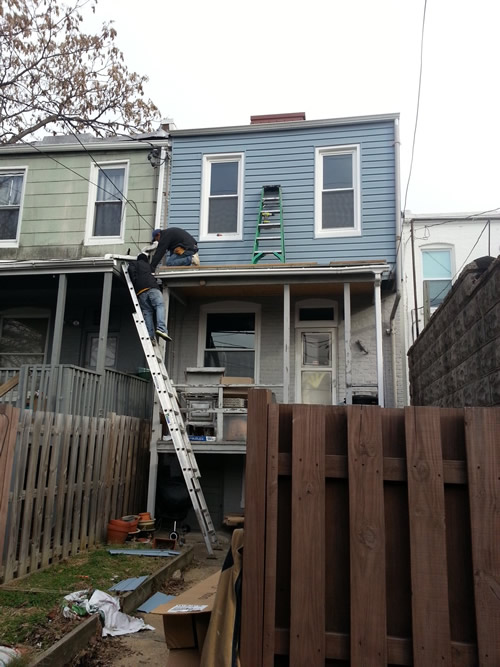 workers replacing home siding Baltimore MD